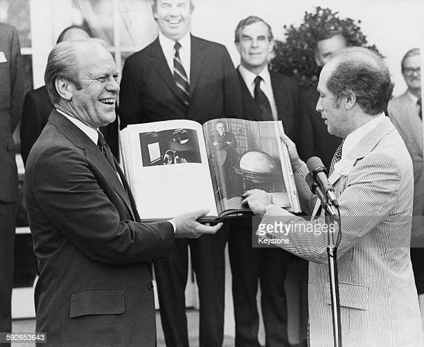 Canadian Prime Minister Pierre Trudeau presenting a Bicentennial gift to US President Gerald Ford, in the Rose Garden of the White House, Washington...