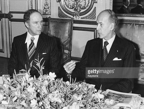 Canadian Prime Minister Pierre Trudeau talking to French President Valery Giscard d'Estaing at a meeting over dinner in the Elysee Palace, Paris,...