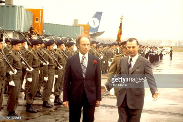 Canadian Prime Minister Pierre Trudeau with Belgian Prime Minister Leo Tindemans review the honor guard during welcoming ceremonies at Zaventem...