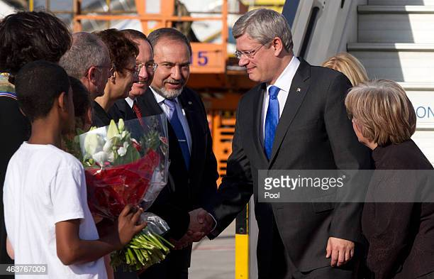 Canadian Prime Minister Stephen Harper and his wife Laureen are greeted by Israeli Foreign Minister Avigdor Lieberman and Israel's Ambassador to...
