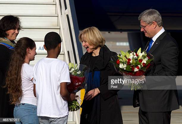 Canadian Prime Minister Stephen Harper and his wife Laureen receive flowers from Israeli school children as they arrive at Ben Gurion Airport January...