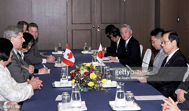 Canadian Prime Minister Stephen Harper and Japanese Prime Minister Yasuo Fukuda talk during their meeting on the sidelines of the G8 Summit on July 6...