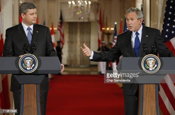 Canadian Prime Minister Stephen Harper and U.S. President George W. Bush hold a joint press conference in the East Room July 6, 2006 in Washington,...