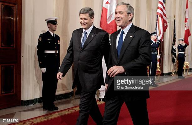Canadian Prime Minister Stephen Harper and U.S. President George W. Bush walk into the East Room for a joint press conference July 6, 2006 in...