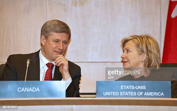 Canadian Prime Minister Stephen Harper and US Secretary of State Hillary Clinton talk during the Haiti Ministerial preparatory conference at the...