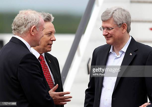 Canadian Prime Minister Stephen Harper speaks with Northern Ireland's First Minister Peter Robinson and Deputy First Minister Martin McGuinness as he...