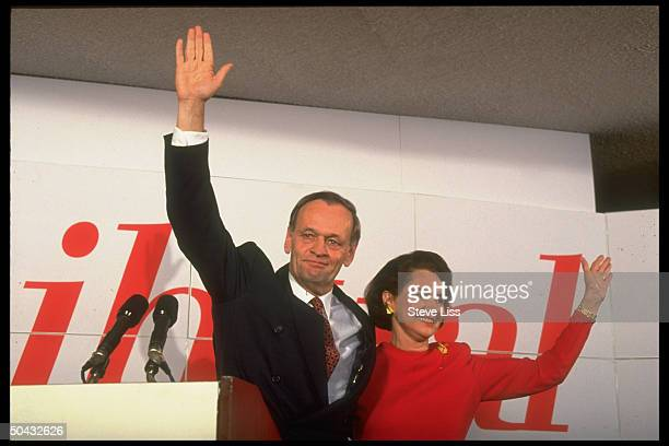 Canadian Prime Minister-elect Jean Chretien waving & smiling w. Wife Aline during victory celebration.