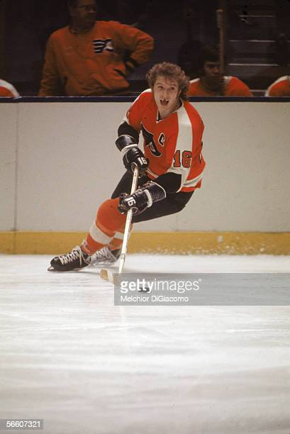 Canadian pro hockey player Bobby Clarke of the Philadelphia Flyers moves the puck up the ice during a road game 1970s