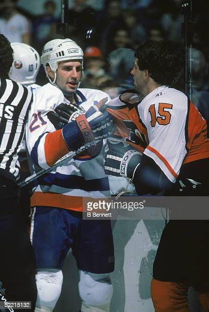Canadian pro hockey player Brent Sutter forward for the New York Islanders grabs his brother Rich forward for the Philadelphia Flyers by the jersey...