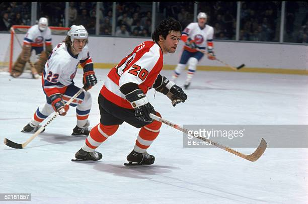 Canadian pro hockey player Jimmy Watson defenseman for the Philadelphia Flyers is trailed by NY Islander Mike Bossy at Nassau Coliseum Uniondale New...