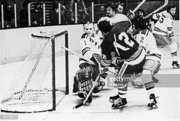 Canadian pro hockey player J.P. Parise of the New York Islanders scores a goal in overtime to defeat the rival New York Rangers in the 1975 playoffs...