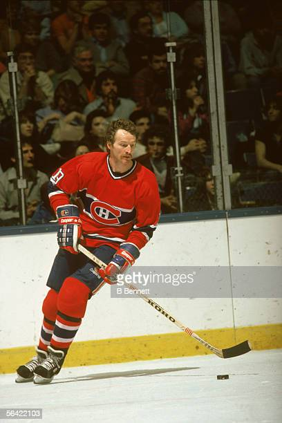 Canadian pro hockey player Larry Robinson of the Montreal Canadiens controls the puck during a road game early 1980s