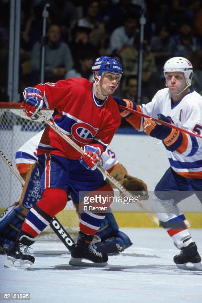 Canadian pro hockey player Ryan Walter forward for the Montreal Canadiens stands in front of the NY Islander goal as Islander defenseman Denis Potvin...