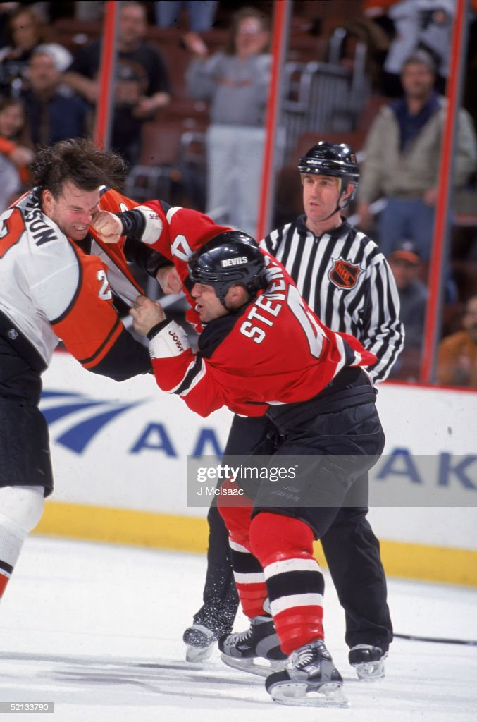Devils' Stevens Punches Richardson Of The Flyers : News Photo