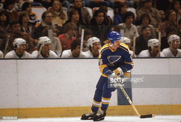 Canadian pro hockey player Tony Currie of the St Louis Blues on the ice in front of the Islanders bench during a game at Nassau Coliseum Uniondale...