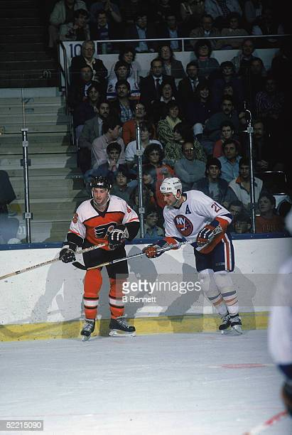 Canadian pro hockey players and brothers Rich forward for the Philadelphia Flyers and Brent Sutter forward for the New York Islanders in action at...