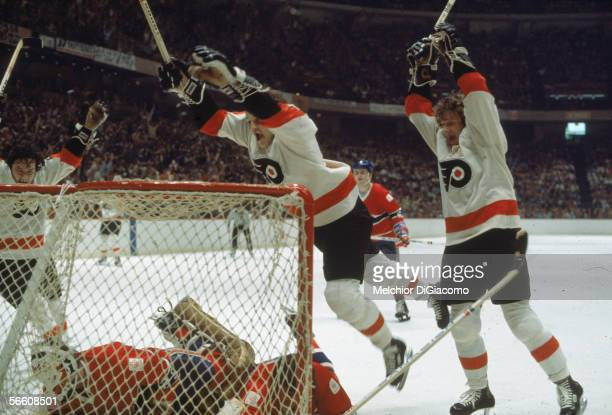Canadian pro hockey players Bobby Clarke Bill Barber and Reggie Leach of the Philadelphia Flyers celebrate a goal against the Montreal Canadiens...