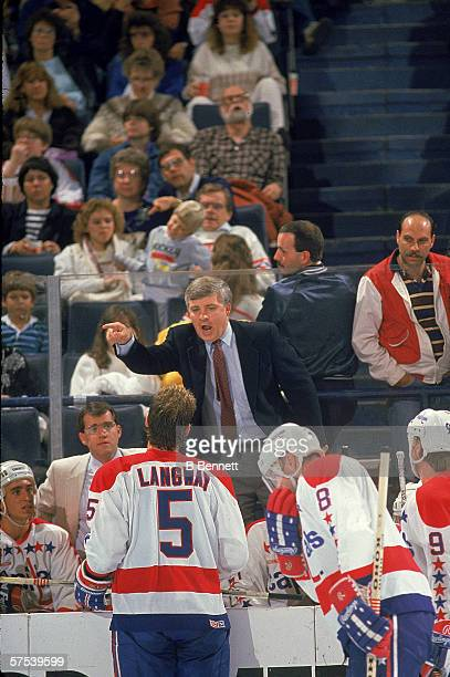 Canadian professional hockey coach Bryan Murray head coach of the Washington Capitals shouts at American professional hockey player Rod Langway from...
