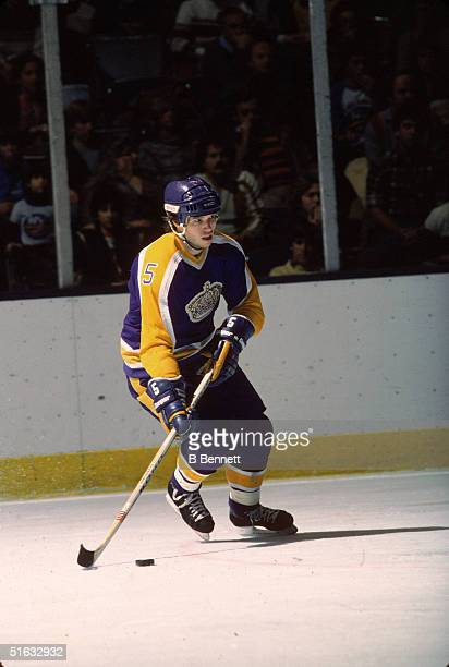 Canadian professional hockey player and 2004 Hall of Fame inductee defenseman Larry Murphy of the Los Angeles Kings skates on the ice with the puck...