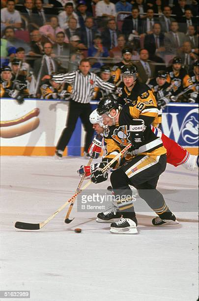 Canadian professional hockey player and 2004 Hall of Fame inductee defenseman Larry Murphy of the Pittsburgh Penguins stick checks Mark Messier of...