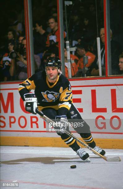 Canadian professional hockey player and 2004 Hall of Fame inductee defenseman Paul Coffey of the Pittsburgh Penguins skates on the ice with the puck...