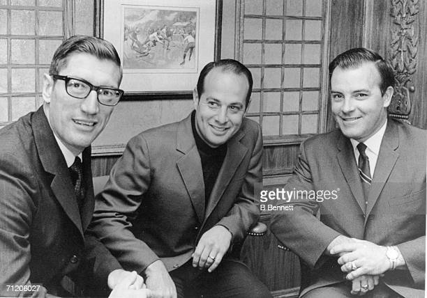 Canadian professional hockey player and coach Al Arbour sits with St Louis Blues vice president Sid Salomon III and team general manager Scotty...