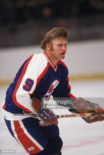 Canadian professional hockey player Bobby Hull, left wing for the Winnipeg Jets, skates on the ice with a bloody face during a game in the 1979 -...