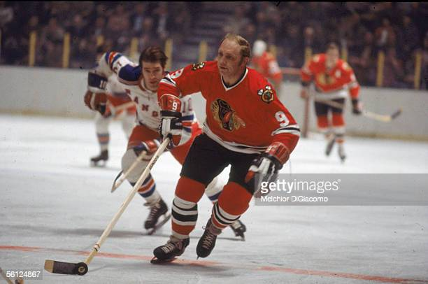 Canadian professional hockey player Bobby Hull of the Chicago Blackhawks skates on the ice during a road game against the New York Rangers as Ranger...