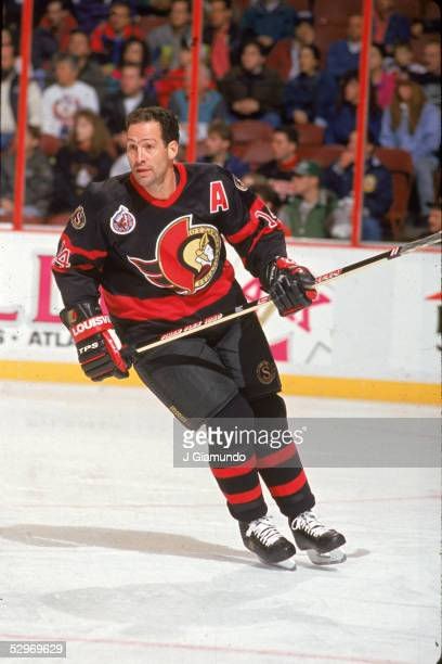 Canadian professional hockey player Brad Marsh of the Ottawa Senators skates and watches the action during a road game, 1993.