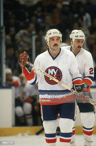 Canadian professional hockey player Bryan Trottier of the New York Islanders on the ice during a home game Uniondale New York 1980s His teammate John...