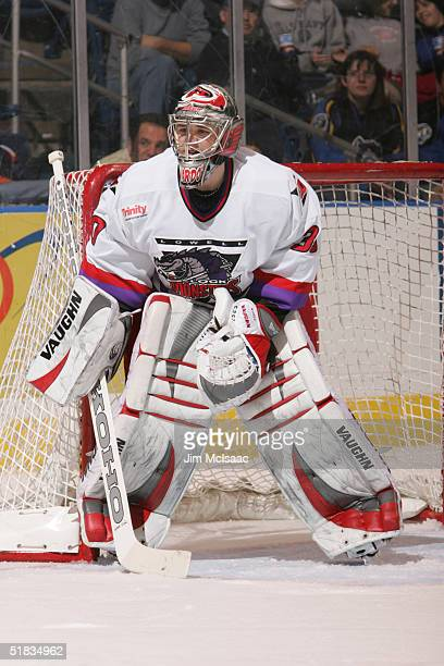 Canadian professional hockey player Cam Ward goalie for the Lowell Lock Monsters tends the goal during a game against the Bridgeport Sound Tigers at...