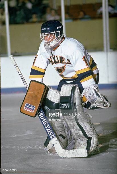 Canadian professional hockey player Darrell May goalie for the St Louis Blues stands readied on the ice during a game October 1986