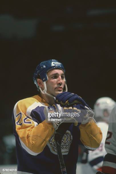 Canadian professional hockey player Dave 'Tiger' Williams of the Los Angeles Kings leans on his stick on the ice during a road game against the New...