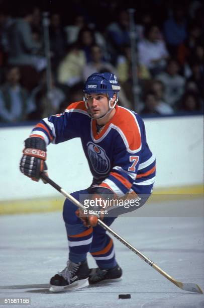 Canadian professional hockey player defenseman Paul Coffey of the Edmonton Oilers skates on the ice with the puck during a game, Edmonton, Alberta,...