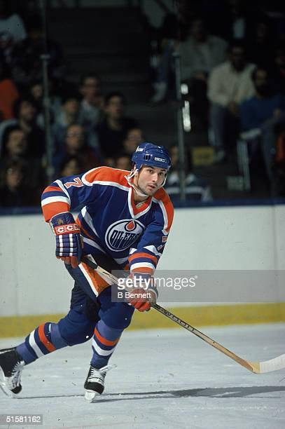 Canadian professional hockey player defenseman Paul Coffey of the Edmonton Oilers skates on the ice during a game Edmonton Alberta Canada mid 1980s