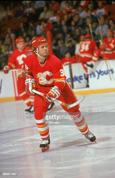 Canadian professional hockey player Doug Gilmour of the Calgary Flames skates on the ice during a road game early 1990s