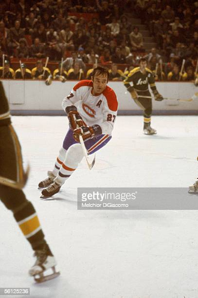 Canadian professional hockey player Frank Mahovlich of the Montreal Canadiens skates on the ice during a home game against the California Golden...