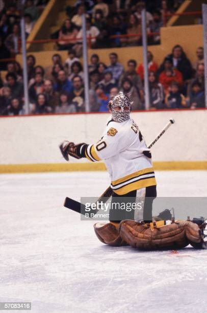 Canadian professional hockey player Gerry Cheevers of the Boston Bruins kneels on the ice during a home game, Boston Garden, Boston, Massachusetts,...