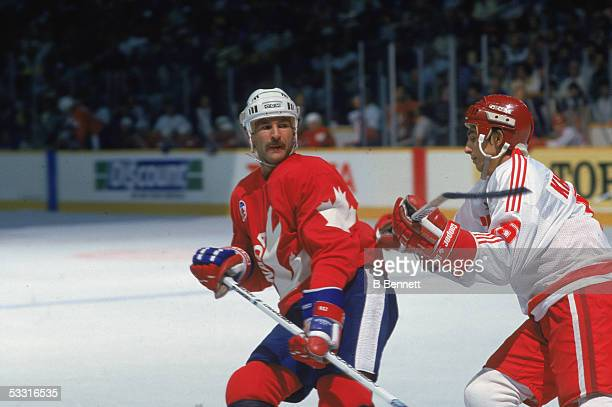 Canadian professional hockey player Glenn Anderson forward for Team Canada fends off an offensive move from a opposing player from Team USSR during...