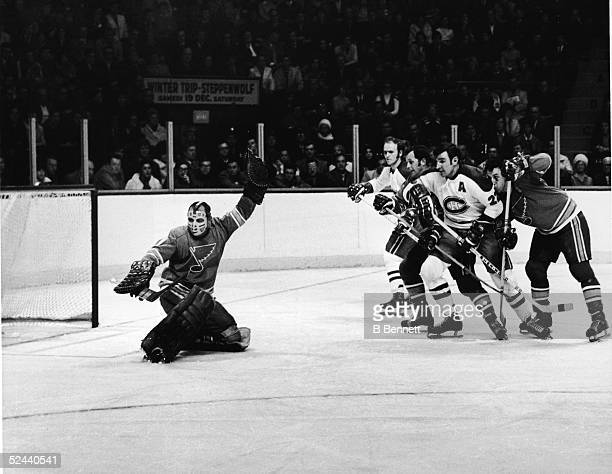 Canadian professional hockey player Glenn Hall goalie of the St Louis Blues makes a save in a game against the Montreal Canadiens Montreal Canada...