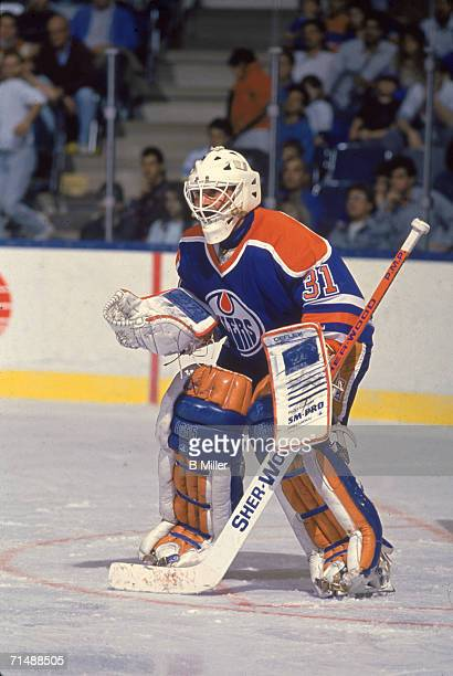 Canadian professional hockey player Grant S Fuhr goalie for the Edmonton Oilers stands readied on the ice during a game early 1990s