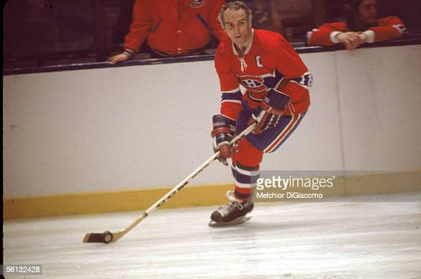 Canadian professional hockey player Henri Richard of the Montreal Canadiens skates on the ice with the puck during an away game early 1970s