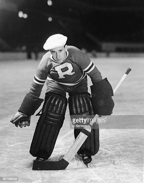 Canadian professional hockey player Johnny Inglis standing in his position as goalie late 1930s Inglis played with the Eastern Hockey League team the...