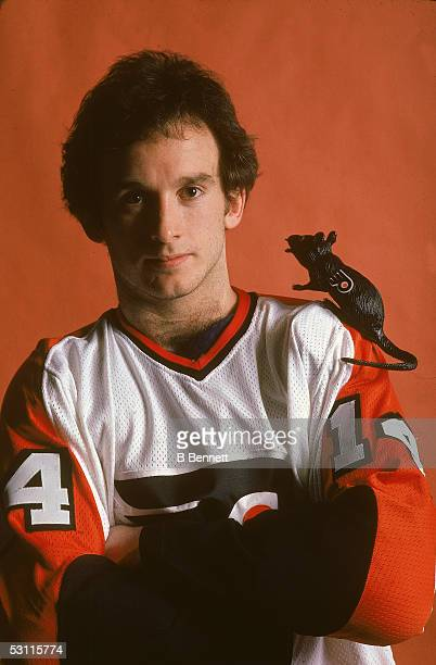 Canadian professional hockey player Ken Linseman forward of the Philadelphia Flyers poses for a portrait in the team jersey with a toy rat which...