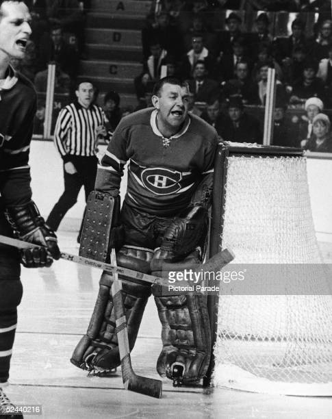 Canadian professional hockey player Lorne 'Gump' Worsley of the Montreal Canadiens shouts at somebody from his position near his net during a game...