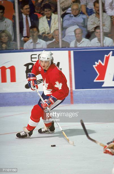 Canadian professional hockey player Luc Robitaille left wing for the Los Angeles Kings and playing for Team Canada follows the puck during the 1991...
