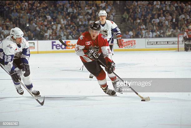 Canadian professional hockey player Luc Robitaille skates on the ice as a member of the North American All Star team at the 1999 NHL All Star Game...