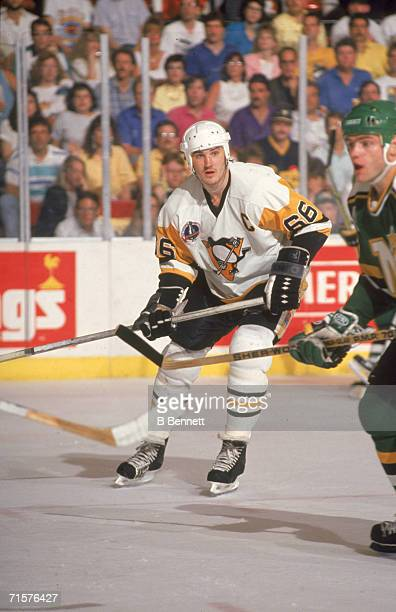 Canadian professional hockey player Mario Lemieux , forward for the Pittsburgh Penguins, and Brian Bellows, right wing for the Minnesota North Stars...