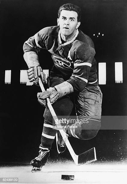 Canadian professional hockey player Maurice 'Rocket' Richard of the Montreal Canadiens skates toward the camera with the puck, late 1940s.