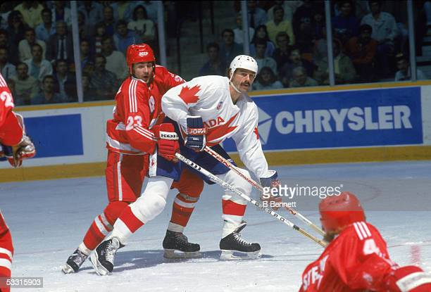 Canadian professional hockey player Michel Goulet forward for Team Canada blocks Russian professional hockey player player Andrei Lomakin of Team...
